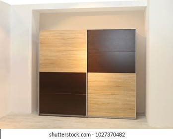 Big Wardrobe Closet With Wooden Doors In Bedroom