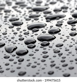 Big water droplets closeup on polished surface