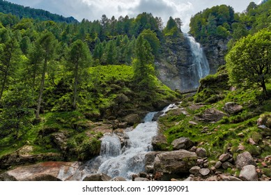 Big Waterfall in the forest, spring season near the little ancient village of Sonogno in Switzerland