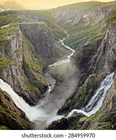 The big waterfall Voringsfossen with its 182 meter fall cascading into Mabodalen valley in Eidfjord, Hordaland, Norway at sunset.