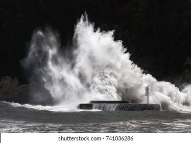 big wave breaking on breakwater on Plentzia