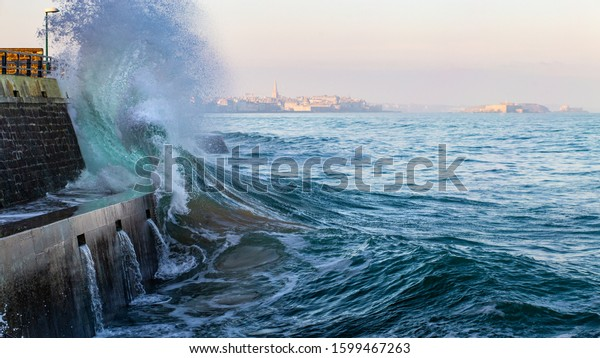 Big wave crushing during high tide in Saint-Malo , Brittany, France
