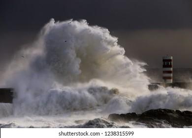 Big wave near a lighyhouse