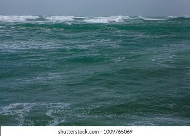Big wave with sea foam and bright Turquoise  water