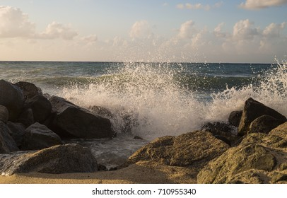 Big wave splash on the sea / Waves break against a rocky shoreline in Calabria Italy region.