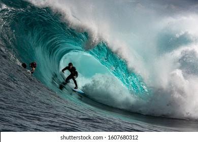 Big wave surfer in a perfect barrel at Shipstern Bluff, Tasmania