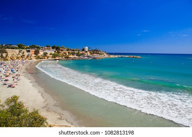 Big wave, turquoise sea and sandy beach in Spain on the Costa Blanca, summer landscape