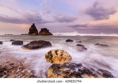 big waves and beautiful rock in the sea,, this is an icon of the beach Sawarna, this icon in the name Tanjung layar ,, this place is located in Banten, Indonesia