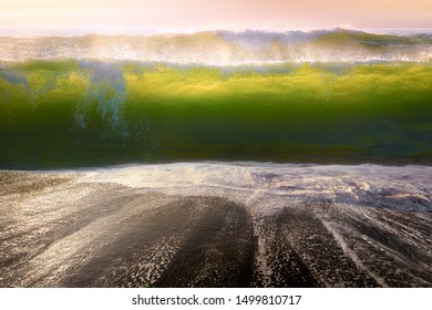 big waves breaking on the beach shore