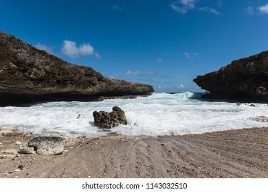 Big waves coming into natural inlet at Shete Boka National Park, Curacao