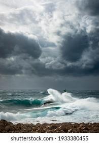 Big waves crushing lighthouse. Photographed in Croatia near Rogoznica on Cape Punta Planka, December 2020