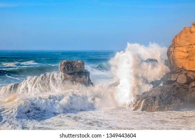 Big waves splash on rocks wild beach in Tamri ait tamer agdir morocco
