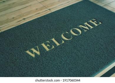 Big Welcome mat on floor.