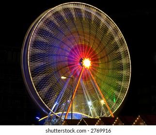 A big wheel blur at a fun fair Berlin