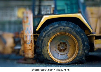 Flat Tyre On a Tractor Images, Stock Photos & Vectors