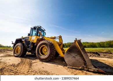 Big wheel loader on a construction site