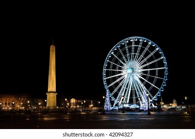 Big wheel and obelisk on Concorde square, in Paris (France)