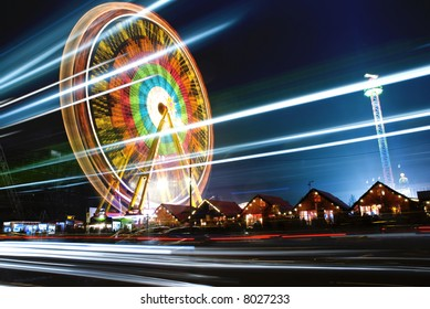 Big wheel at one of Belrins Christmas markets, travel and blur background