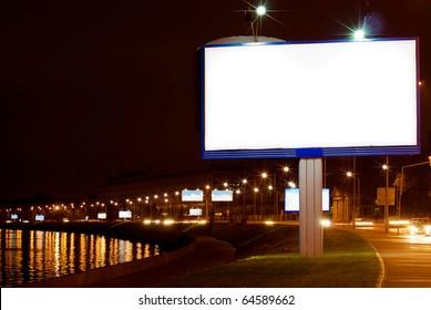Big white billboard on night quay of Sankt-Peterburg