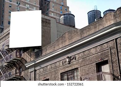 Big, white, blank, billboard on the grey brick building.