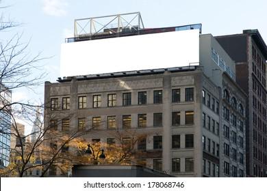 Big, white, blank, billboard on the grey building. Manhattan, New York.