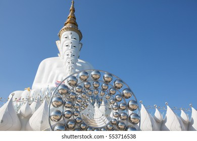 "Big white buddha statue isolated on blue sky at new popular Public Temple in Phetchabun (in the north of Thailand) ""Wat Pha Sorn Kaew"" Picture in January, 2017"