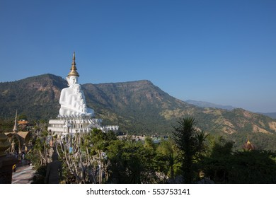 "Big white buddha statue isolated on blue sky at new popular Public Temple in Phetchabun (in the north of Thailand) tourists crowded  ""Wat Pha Sorn Kaew"" Picture in January, 2017"