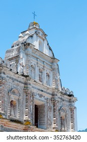 Big White Church With stone Carvings in front of blue sky in quetzaltenango Guatemala