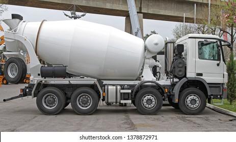 Big White Concrete Mixer Truck at Construction Site
