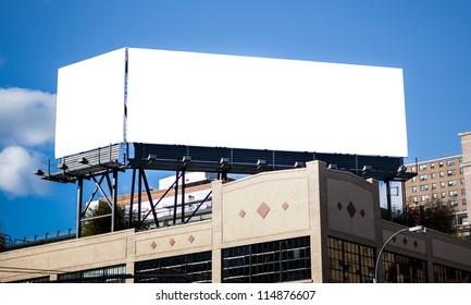 Big white double billboard in big city.