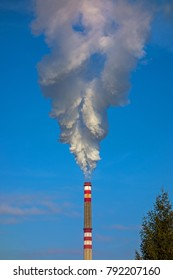Big white smoke from the factory chimney. The smoke has the form of spirit