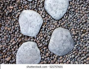 Big white stone walk way on the little rock garden.