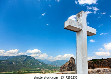 Big white wooden cross on the sky background.  Meteora, Greece.