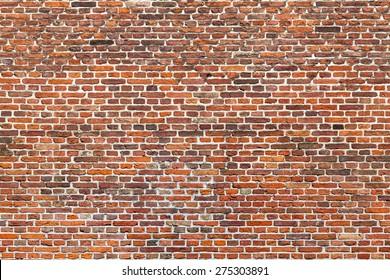 Big wide wall of bright and dark red bricks/Large Brick Wall