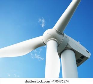 big wind turbine on blue sky background
