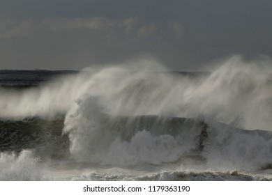 Big windy breaking waves in a stormy afternoon.