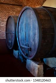 Big wine barrels in a cellar, vertical image