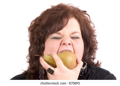 Big woman taking a big bite out of a pear