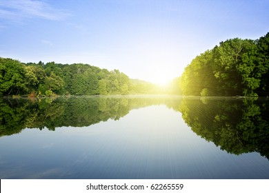The big wood lake with bright sun in the spring