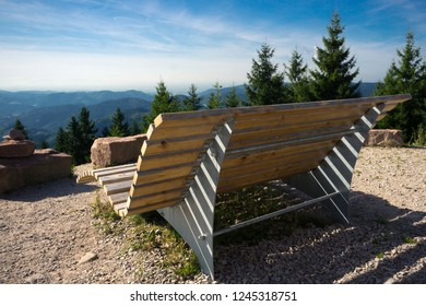 Big Wooden Bench on a viewpoint in Blackforest Landscape in Summertime