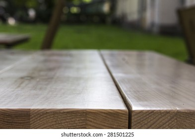big wooden table and garden