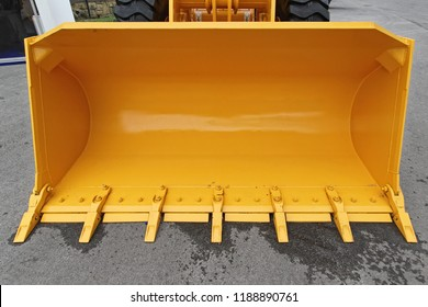 Big Yellow Bucket Scoop at Front Loader Machine