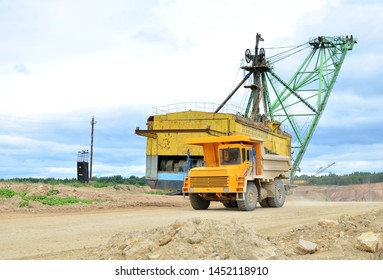 "Big yellow dump truck working in the limestone open-pit. Loading and transportation of minerals in the dolomite mining quarry. Belarus, Vitebsk, in the largest i dolomite deposit, quarry ""Gralevo"""