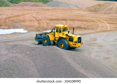 Big yellow earth mover, tilt-shift photo