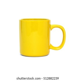 Big yellow empty tea or coffee cup isolated on white background front view closeup