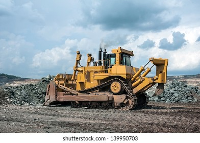 big yellow excavator at work site