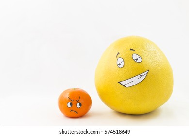 A big yellow honey pomelo and a tangerine with funny faces and white background