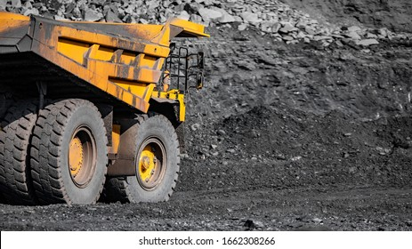 Big yellow mining truck for coal move. Open pit mine industry.