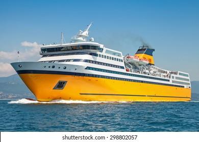Big yellow passenger ferry goes on the Mediterranean Sea