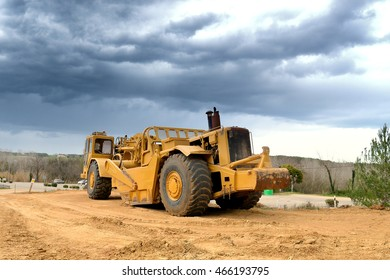 Big Yellow Road Construction Machine